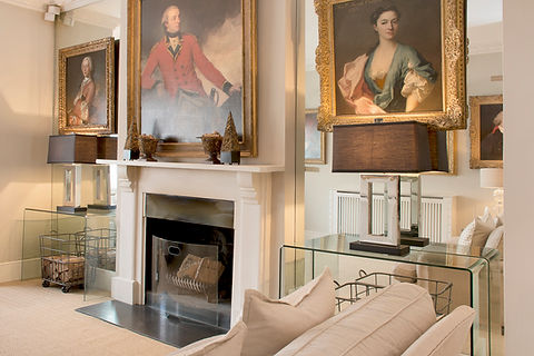 London Townhouse fireplace artowkr symmetry lighting glass tables wire baskets neutral classic