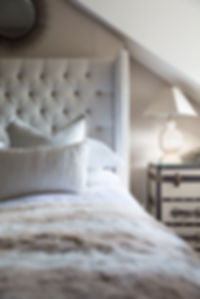 London Boutique Residences bedroom upholstered headboard trunk side table details