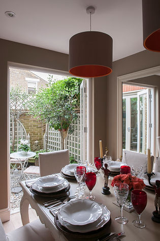 London Townhouse dining room garden open doors tablescape red accents