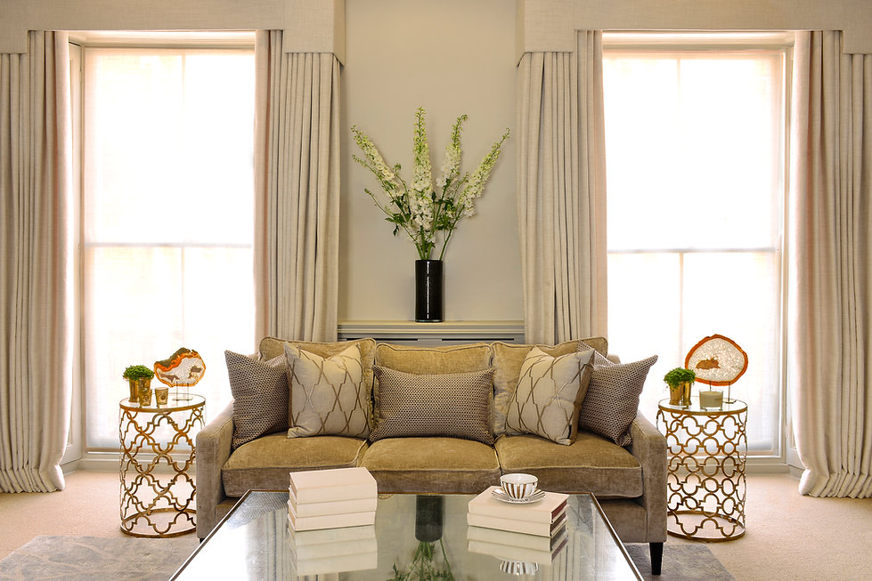Chelsea Townhouse luxury couch metal and glass side tables symmetry draped curtains