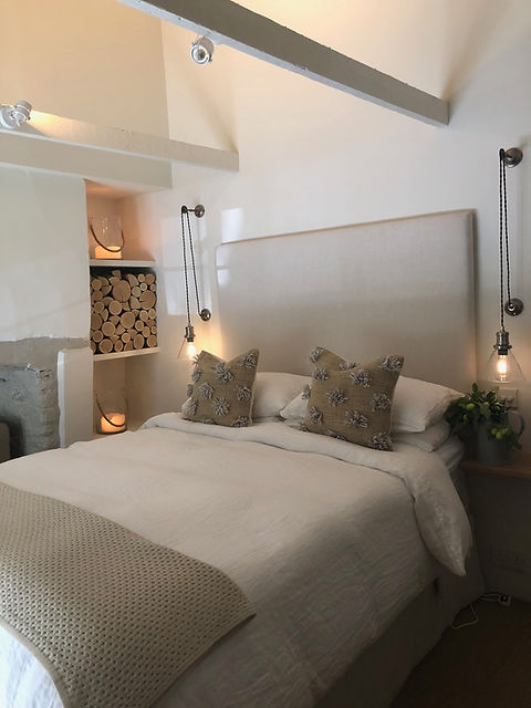 Cotswolds Cottage bedroom headboard exposed beams glass lamps hanging lights