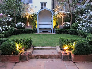 London Townhouse garden bench evening outdoor lighting