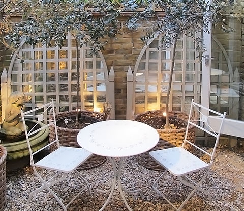 London Townhouse garden bistro table metal chairs woven planters