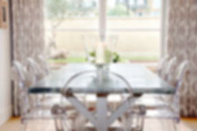 London Townhouse dining room views ghost chairs
