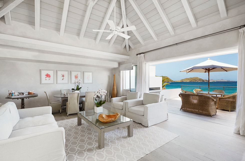 Hotel Cheval Blanc Isle de France suite ocean views white furnishings rattan umbrella sun