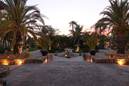 Resort Hotel Mexico courtyard fountain palm trees evening lighting levels