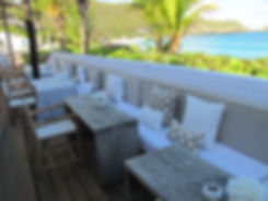 Hotel Cheval Blanc Isle de France outdoor seating ocean views palm trees