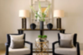 Chelsea Townhouse symmetry black chairs metal and glass side table