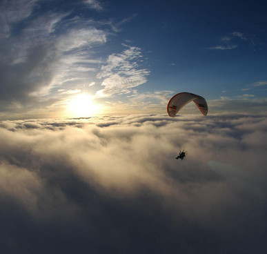 gara gliding above the clouds