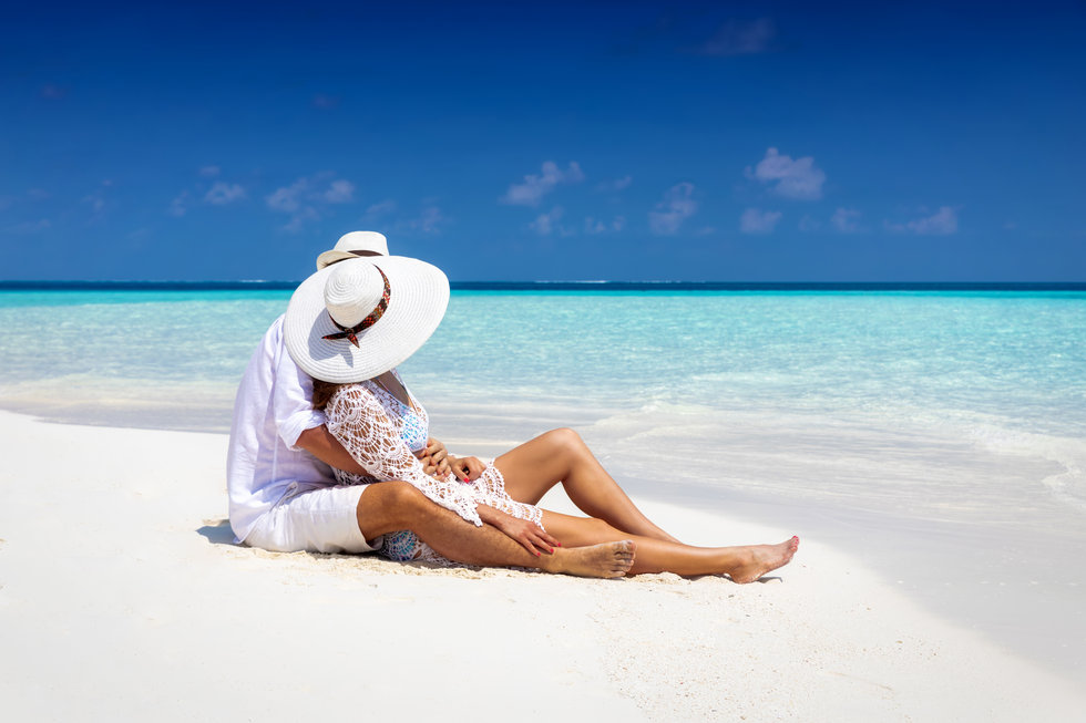 Romantic couple in white summer clothes