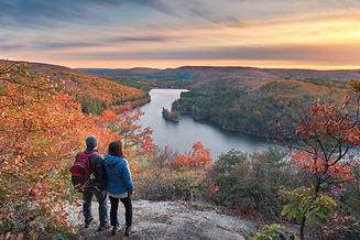a couple of hikers taking in the spectacular autumn view at sunset.jpg