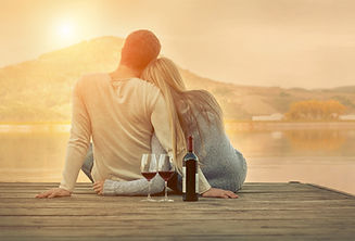 Romantic Couple sitting on the pier with red wine..jpg