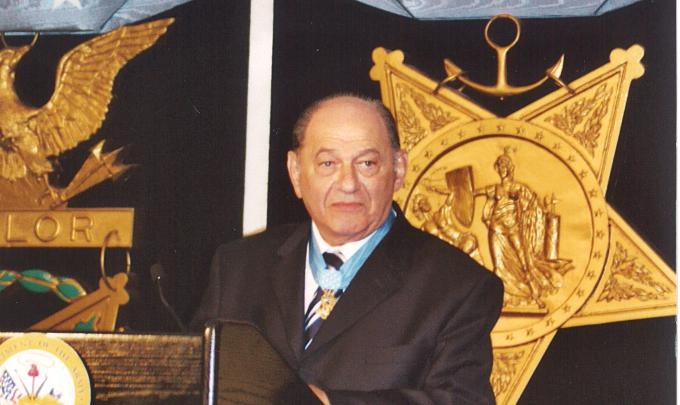 Tibor receives his medal in 2005
