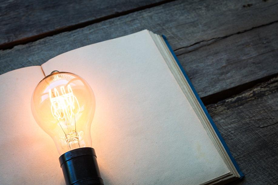 vintage-book-light-bulb-wood-table.jpg