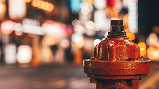 Red fire hydrant, a fire hydrant on the street with bokeh in background.jpg