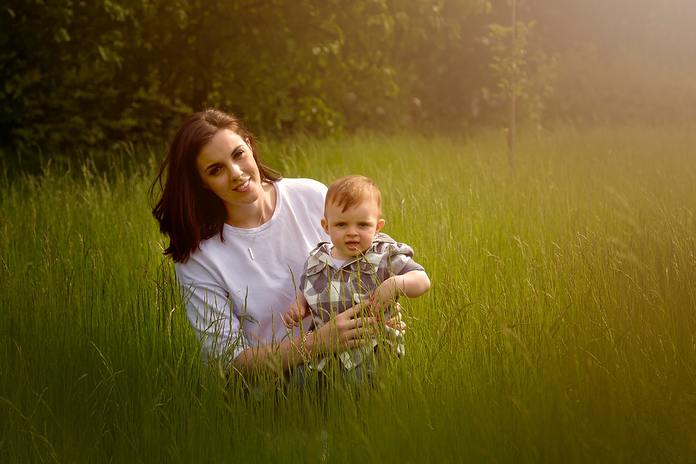 beautiful mother and baby portrait in long grass during sunset, kent outdoor photography sessions