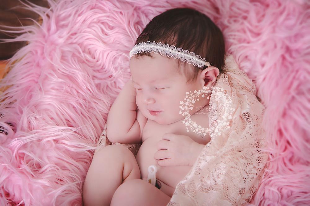 a stunning newborn tieback being worn by baby girl during her newborn photo session in our dartford, kent studio