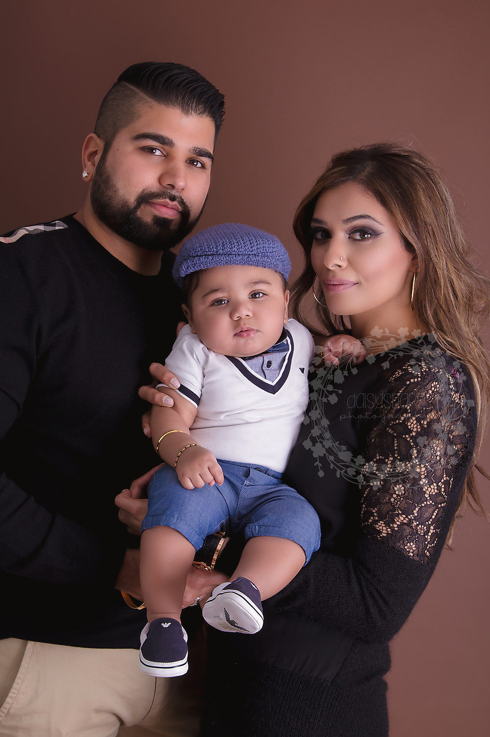 Family portrait with mum and dad holding baby boy during their family photo session