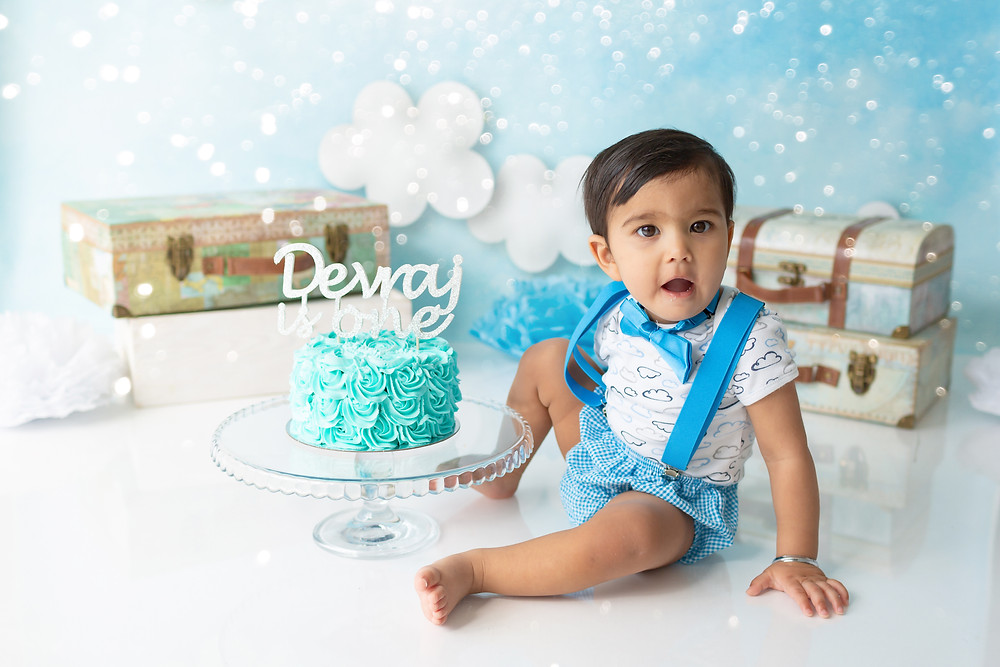 Cake Smash photography, Baby Photographer Kent, cute little boy posing first birthday cake photo session