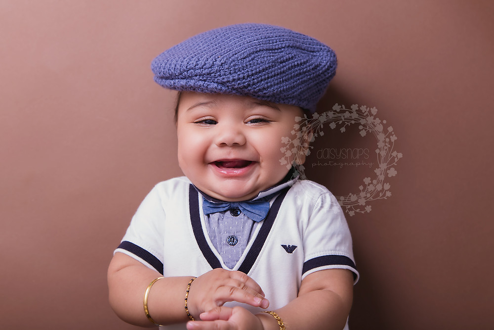 very cute smile at baby photographer in the kent photo studio