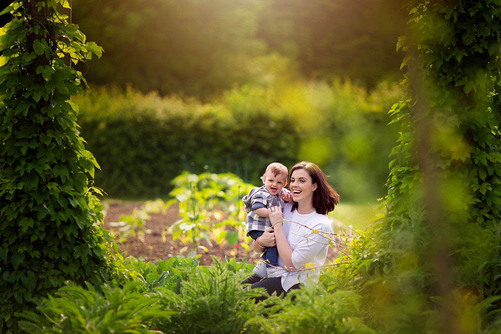 Outdoor portrait of mum and baby sitting in the sun, family photo sessions kent
