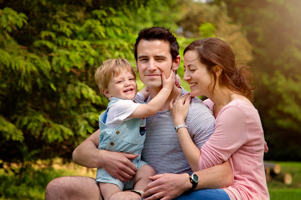 beautiful family portrait of mum dad and baby boy,family photographer kent, family photographers, hall place, outdoor photo sessions, woodland photo sessions, photographers in kent, family photo shoots, location photo shoots
