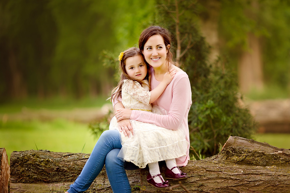 mum and daughter hugging, family photographer kent, family photographers, hall place, outdoor photo sessions, woodland photo sessions, photographers in kent, family photo shoots, location photo shoots