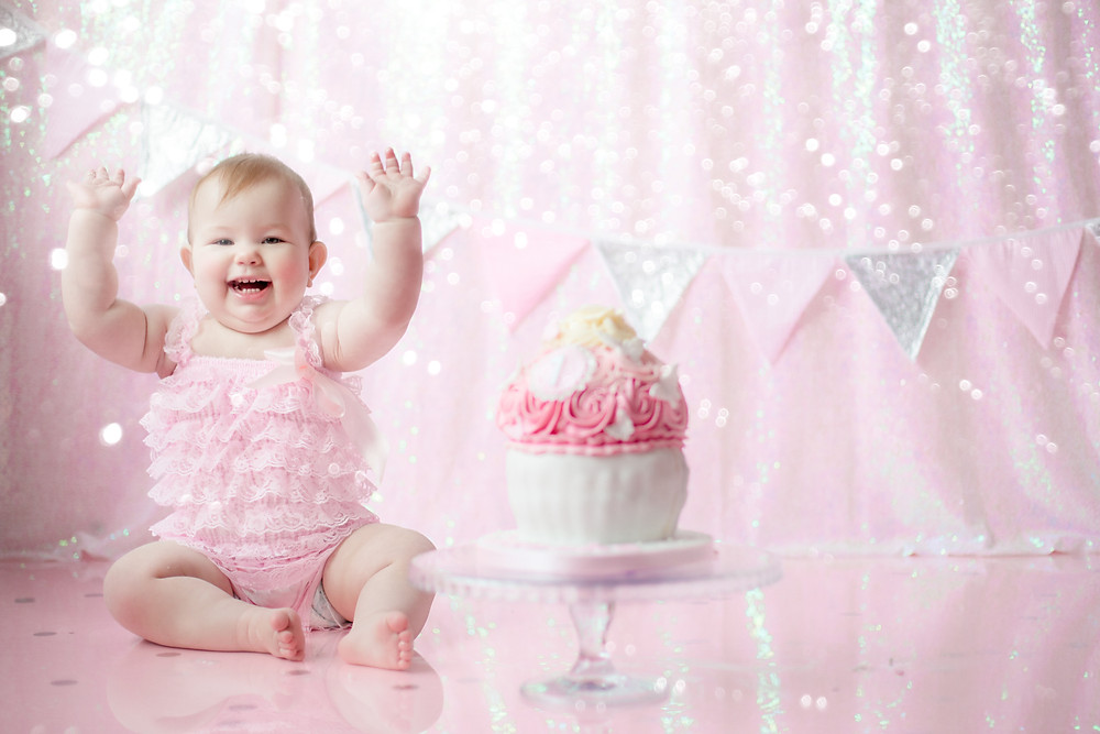 pink glitter themed cake smash  & splash   kent cake smash photographer