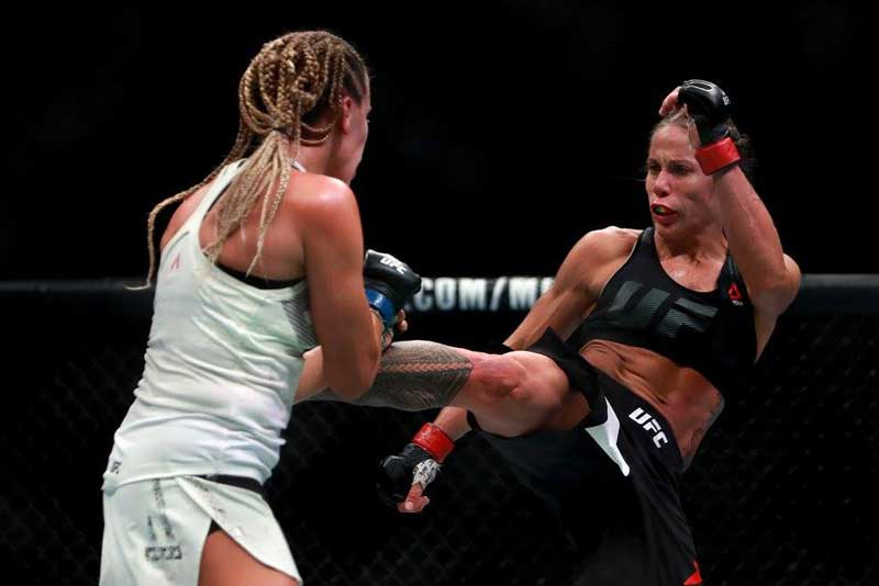 Liz-Carmouche-kicking-Katlyn-Chookagian-at-UFC-205-from-UFC-Facebook
