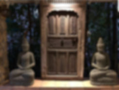 Antique door and stone Buddhas
