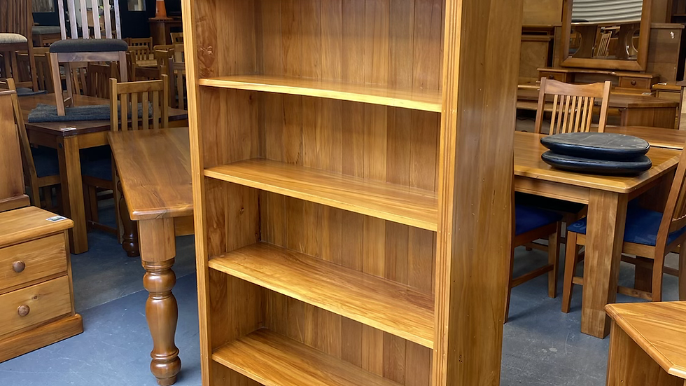 Solid rimu bookcase with fixed shelves
