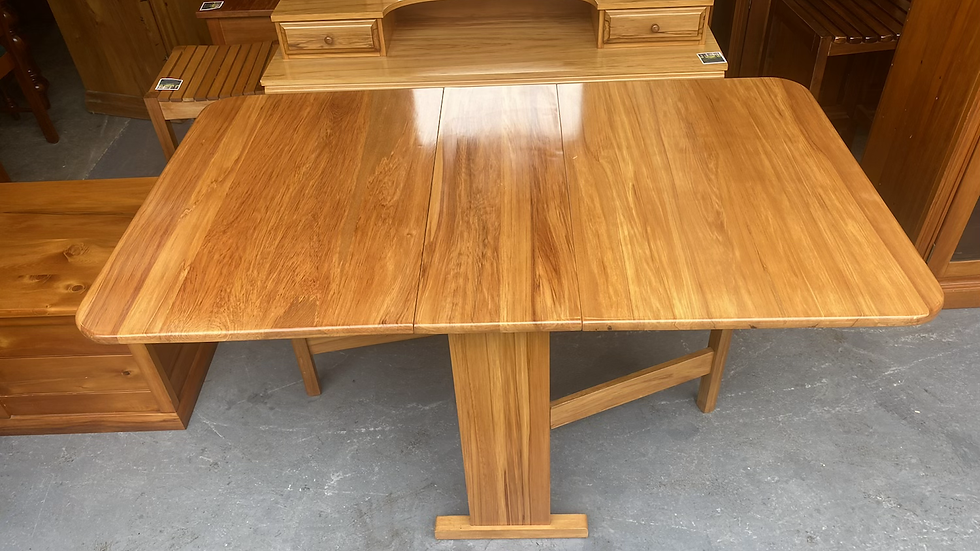 Solid Rimu drop leaf table only.