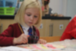 Year 2 pupil painting