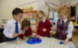 Reception Class pupils learning