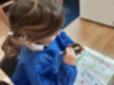 Reception Class pupil painting