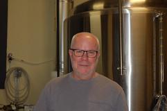 Kurt Beigel and a brewing tank