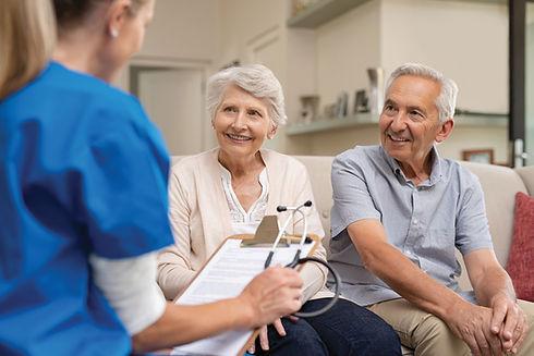 senior-couple-consulting-nurse-125353349.jpg