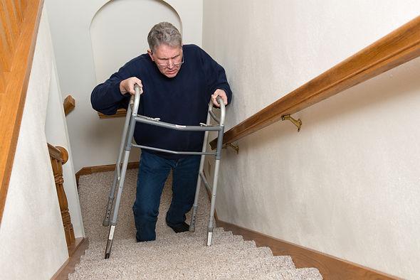 elderly-man-climb-stairs-walker-64288331(1).jpg