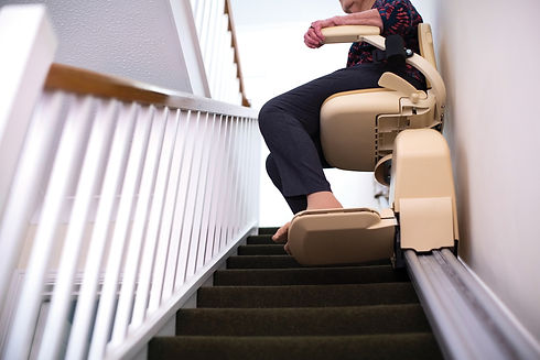 detail-of-senior-woman-sitting-on-stair-lift-at-home-to-help-mobility-135607519.jpg