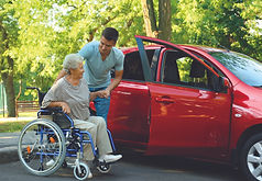 young-man-helping-disabled-senior-woman-in-wheelchair-to-get-into-car-160212321.jpg