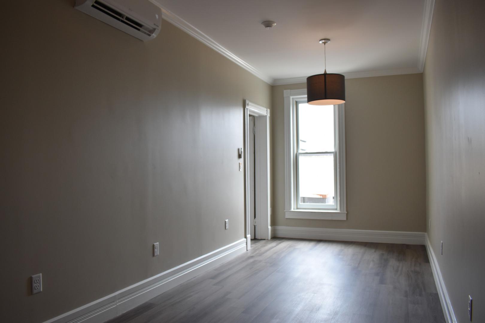 Bedroom w/ Air Conditioner