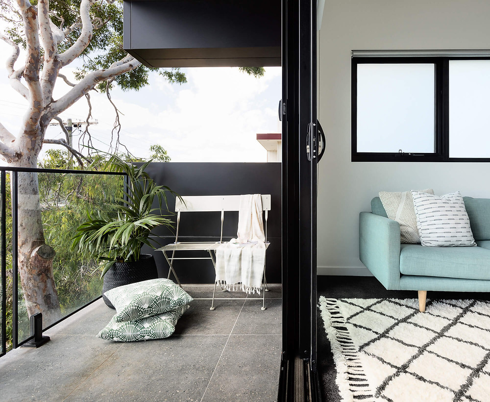 terrace with chair leading to couch in living space