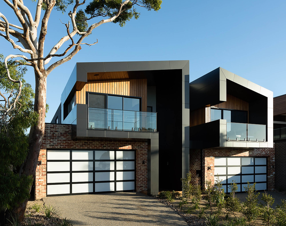 bold geometrical duplex featuring alucobond and recycled red bricks