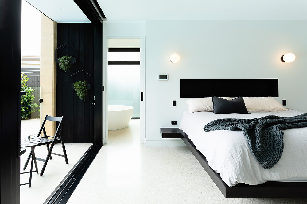 Master bedroom with ensuite, platform bed and terrace