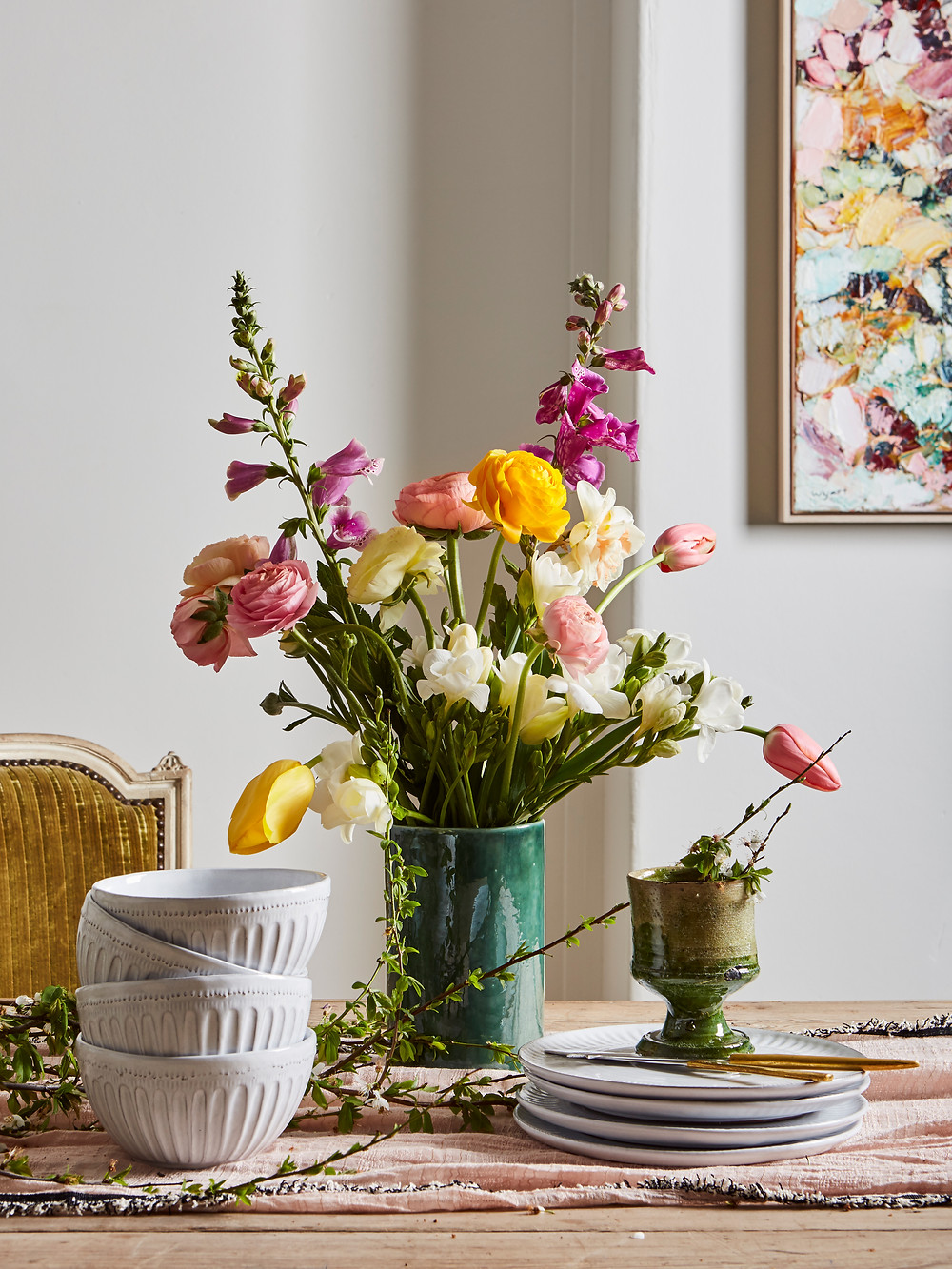 vase with loose floral table setting