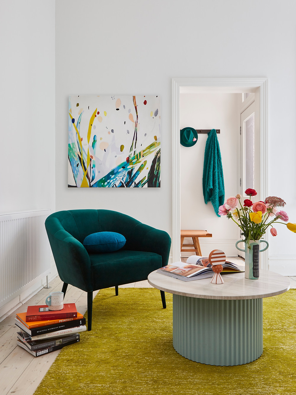 living room with teal green sofa