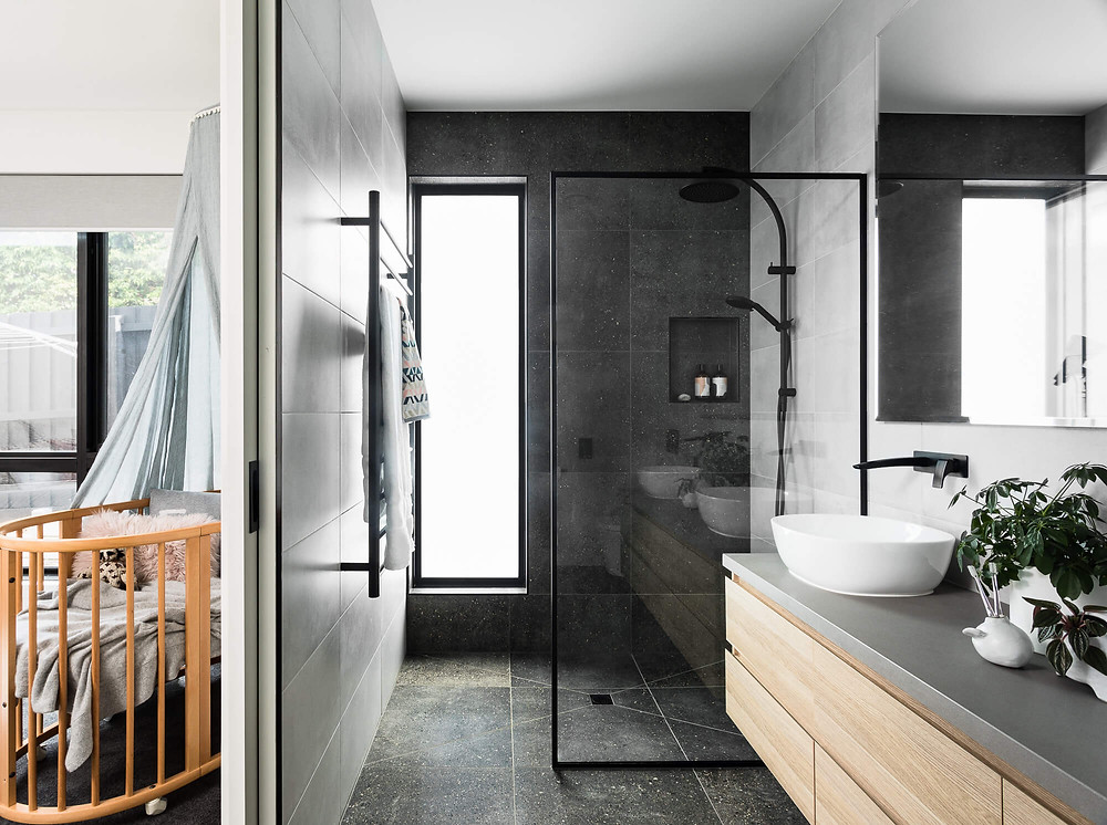 bathroom with walk in shower above counter basins