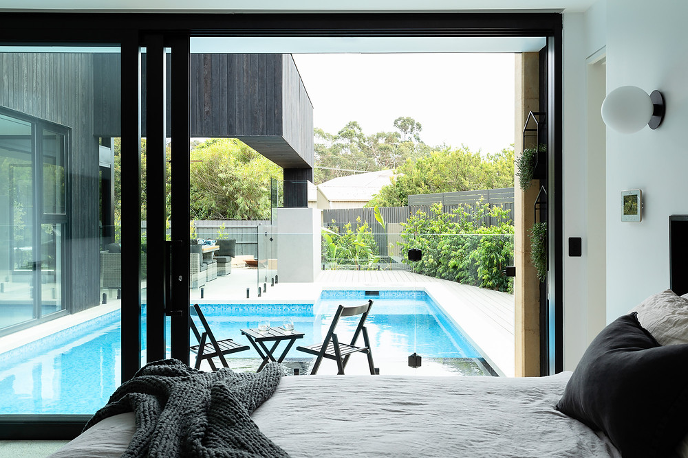 master bedroom terrace with view of pool