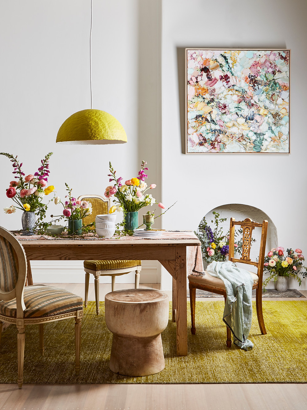 dining room with florals and art yellow tones