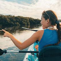 Kayak Eco Tour tourists kayaking in the mangroves of the Everglades, Keys, Florida, USA tr